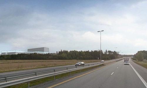 Illustrasjon viser den nye planlagte fabrikken sett fra E6 mot sydøst.
